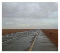 صور من الأمطار الخفيفه التي هطلت على الجويفاء